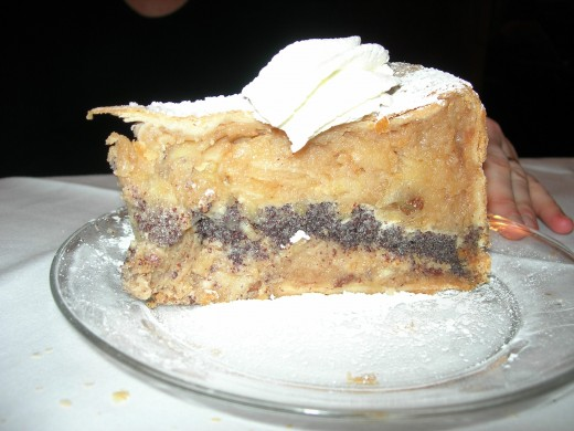 """The Frauenhuber is a famous old cafe and this is its even more famous """"Haustorte."""" It's not as sweet as it looks, and it's quite delicious. The Frauenhuber is on the ground floor of a building on Himmelpfortgasse. Wolfgang gave concerts on the next floor up, in what used to be Jahn's Coffeehouse. In MOZART'S LAST ARIA Nannerl meets Prince Lichnowsky at Jahn's. They eat something a little like this Haustorte…Well, who could resist? After all, a mystery must include some sins."""
