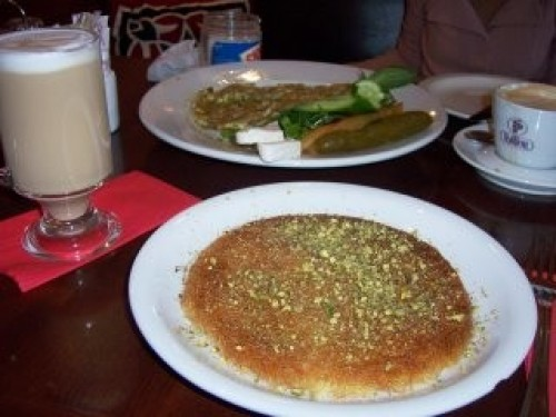 Nablus is famous among Arabs for its qanafi, hot goat's cheese covered in syrup. The less serious element of The Samaritan's Secret is the question of whether Omar Yussef -- who doesn't like sweets -- will eat any during his visit.