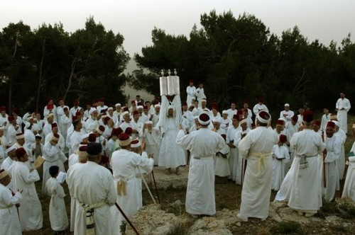 "Samaritans celebrate Passover on Mount Jerizim. They maintain ancient Jews once observed Passover this way. Their High Priest says their Torah and that of the Jews are the same, ""except for 7,000 errors in the Jewish one."""